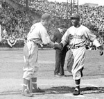 Jackie Robinson playing baseball