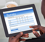 Student taking survey on a tablet