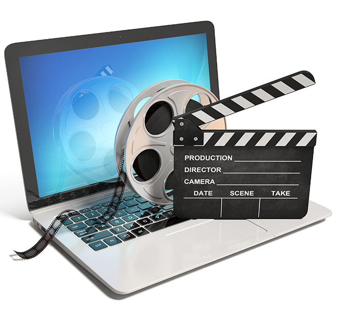 laptop with reel and movie clapper