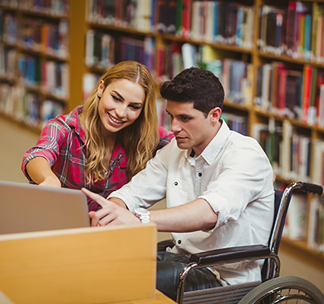 Student in wheelchair working with a classmate