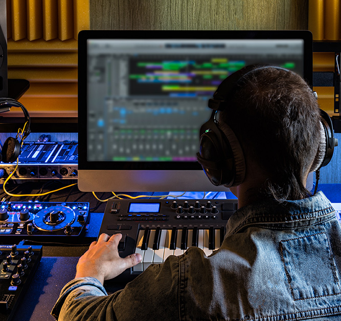 Man in front of music production equipment