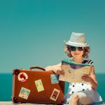 woman with vintage suitcase and city map on vacation