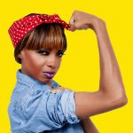 woman dressed as the iconic Rosie the Riveter