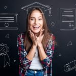 Joyful delighted smiling student imagining celebrating graduation