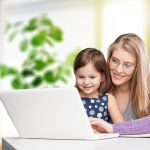 woman working on laptop with child