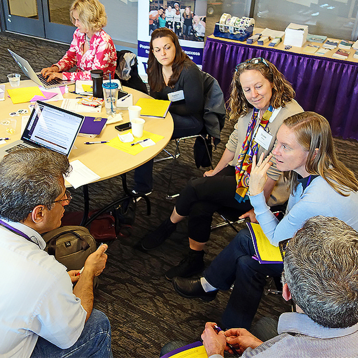 Participants in discussion at the Accessible IT Institute