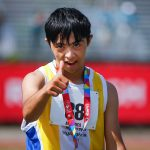 Special Olympics athlete giving the camera a thumbs up