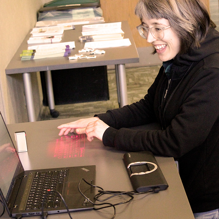 Maddie Romansic tries out assistive technology. Photo by Elizabeth Lee