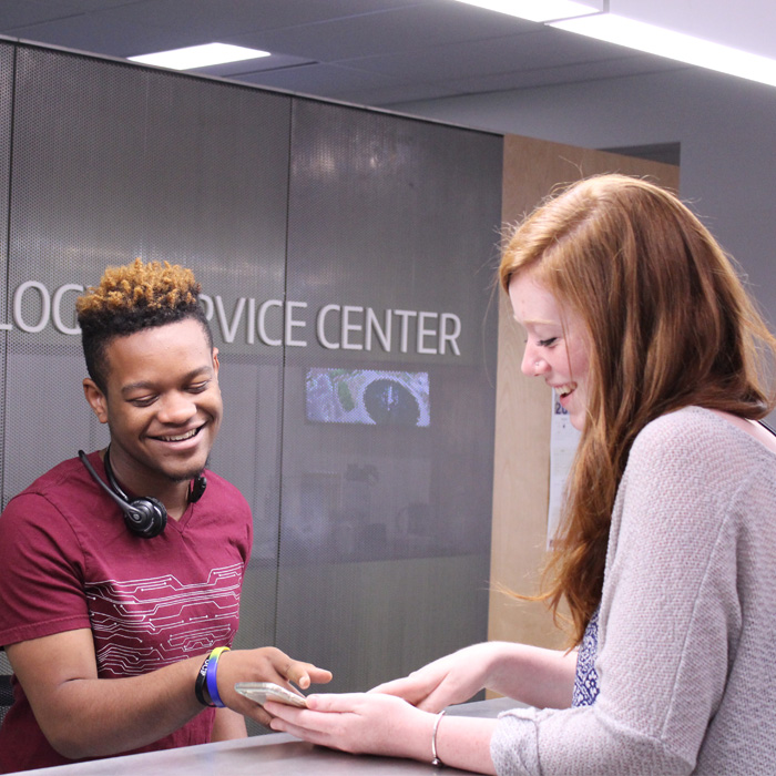 Techology Service Center employee helps a customer at the Help Desk