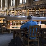 Student studying in Suzzallo Library