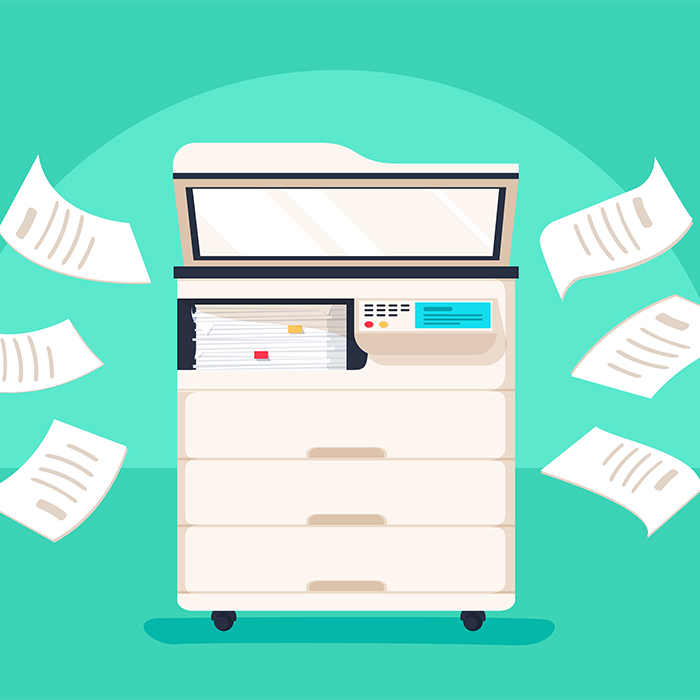 Photo of a multifunction copy machine with flying papers around it