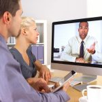 Business team consulting over videoconferencing