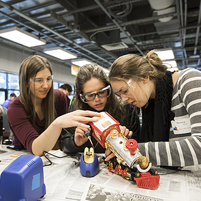 Students volunteer at the Holiday Toy Hackathon modified store-bought toys to make them accessible for kids with motor limitations or developmental disabilities