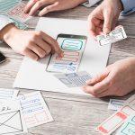 ux designer designing web and smartphone layout