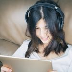 girl is watching online video on tablet