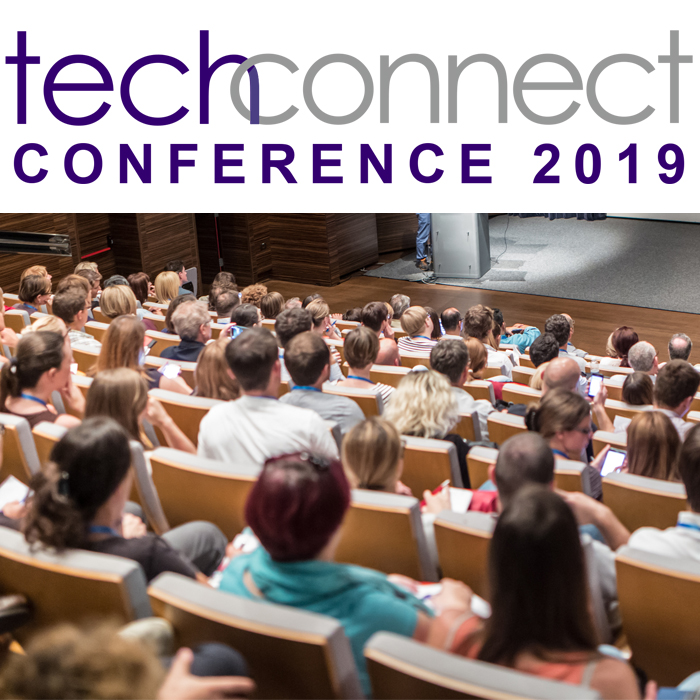 "Lecture hall filled with people with ""TechConnect conference 2019"" written over the photo"