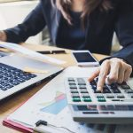 Person working at a desk office business financial accounting
