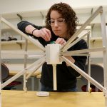 Ruby Bryne demos the technology she developed to help optimize a telescope half a world aways