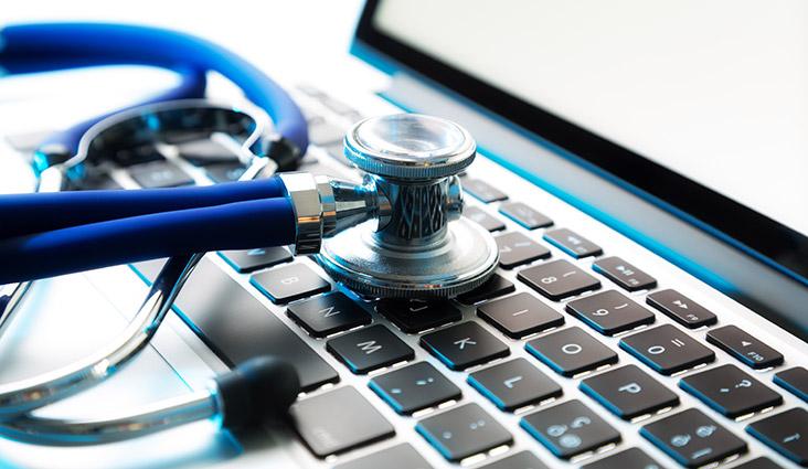 A stethoscope on a laptop keyboard.