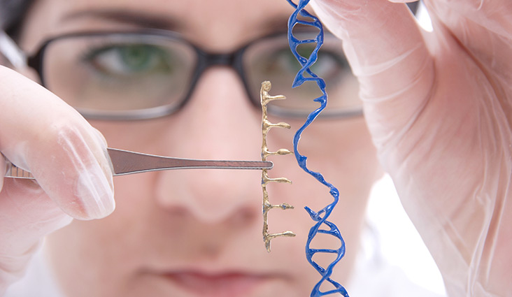 Image of a scientist working with a DNA strand.