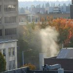 Gas plumes rise up from a street on the University District