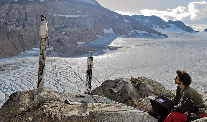 Researchers work by a glacier