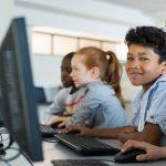 Children using computer in school