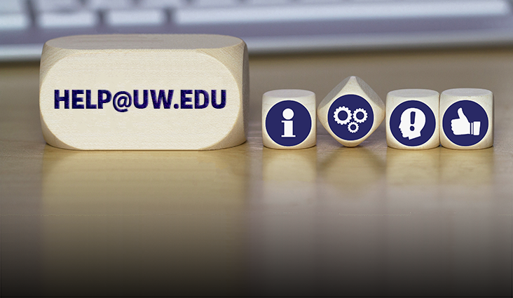 Wooden blocks showing help-related icons and help@uw.edu